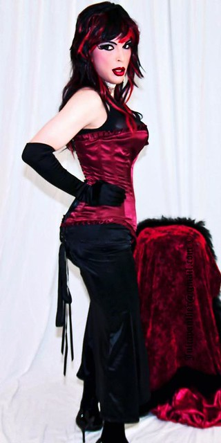 Red satin corset and long hobble skirt