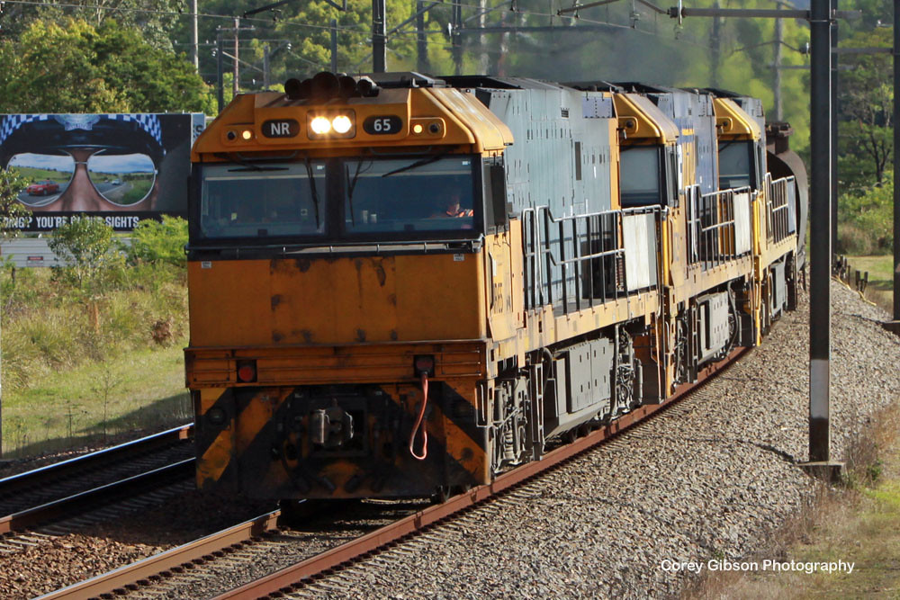 NR65, NR29 & NR49 haul the steel train through Ourimbah by Corey Gibson