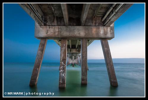 sunset beach island pier fishing long exposure florida fort under underside fl underneath posts destin walton okaloosa