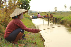 People Fishing On the River