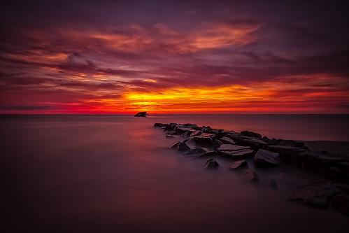 ocean sunset red sky orange water clouds concrete pier newjersey rocks long exposure ship purple jetty nj atlantis sunsetbeach capemay sunken uss capemaycounty