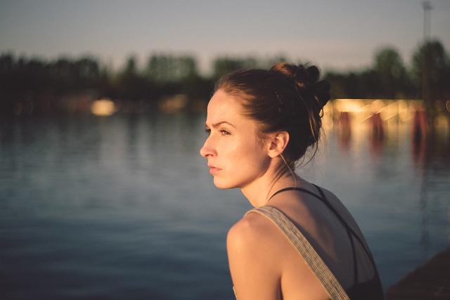 Pensive girl at the lake