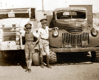 """May 1942 - Australian Army 1/2 Movement Control Group Driver Tom Beazley, with his Chevrolet 3.0 Ton GS truck & a young local """"assistant"""" at the Allied Vehicle Workshops & Depot, El Kantara East, Egypt"""