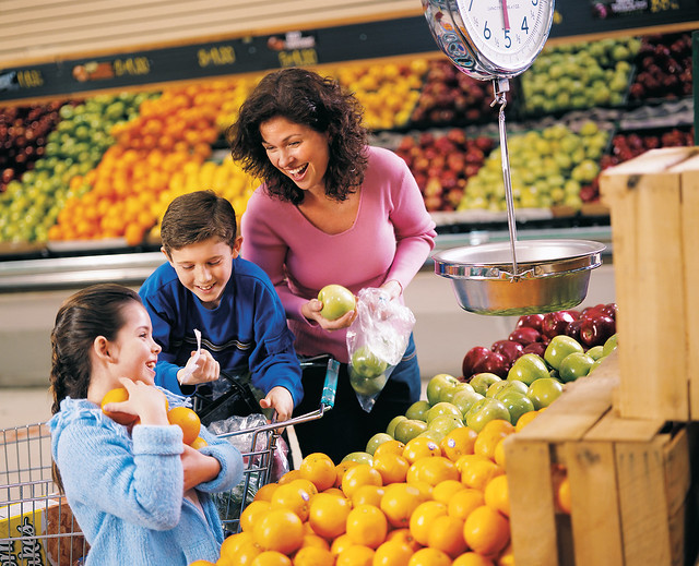 Children shopping with a parent in a grocery store
