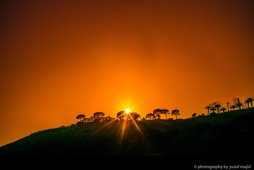 mysticism daylight light nature green landscape hill trees flame bright yellow star sun orange sunset