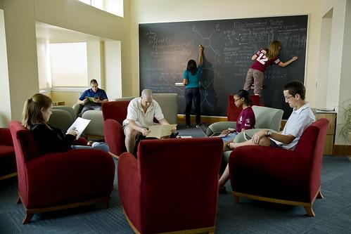 Students in Lobby Beside Chalkboard