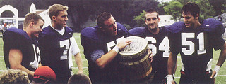 Pomona-Pitzer won the annual Drum contest against Occidental College in 1999, 28-0. In the photo, Shawn Hochuli PI '00, Jake Howard '00, Matt Campbell '00, Jesse Huttenbrauck '00 and Joe McMullen '00 celebrate with the drum.