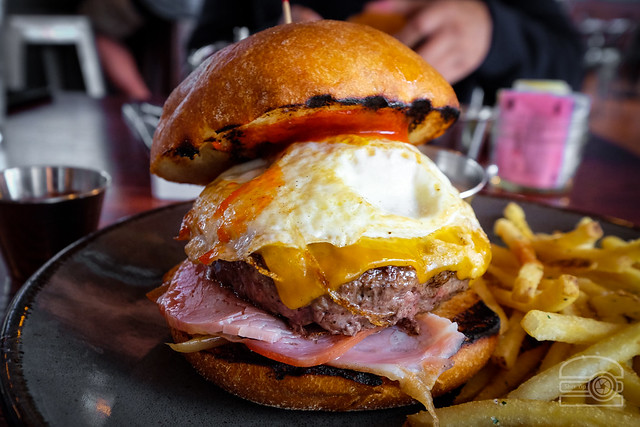 Burger w/ Cheddar, Canadian bacon, caramelized onions, pepper jam, and Fried Egg - Table 9
