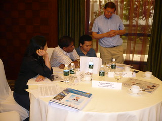Commercial Fundamentals of the Upstream Oil & Gas Industry - Trainer with Delegates at Brainstorming Session | by Neoedge Gallery