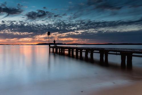 australia au newsouthwales nsw portstephens nelsonbay littlebeach beach water pier jetty sky clouds sand shore fishing sunset