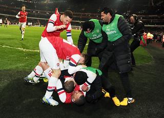 Arsenal players celebrate Jack Wilshere's goal