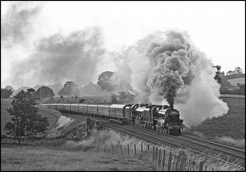 A SLOA railtour was organised to celebrate the 25th anniversary of 1T 57 - the BR farewell to steam special of August 1968. In the event, only one of the original four locos was available and 44871 follows its route of 25 years previously as it pilots 45596 with the tour south of Appleby.