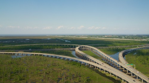 aerialview bridge canal cloudless cloudlesssky clouds day daylight daytime flatland freeway fromadistance horizon horizontal intersection lake lakepontchartrain lookingdown marsh marshland msy neworleans nobody outdoor river road scenic water