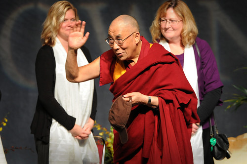 His Holiness the Dalai Lama waves to the audience