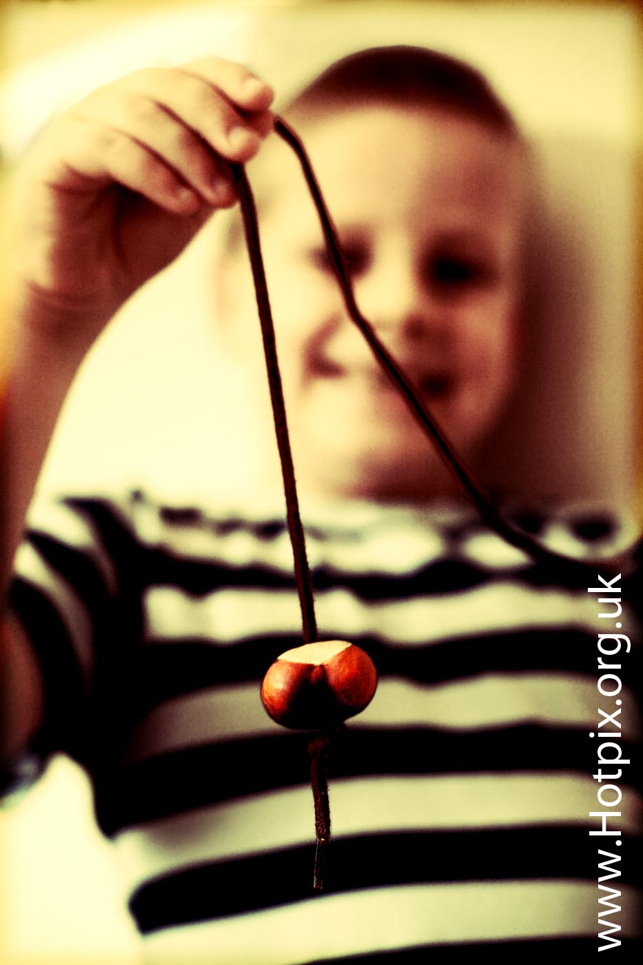 conker,conkers,bonkers,boy,holding,shoelace,shoe,lace,horse,chestnut,grappenhall,school,yard,matthew,schoolyard,narrow,dof,depth,field,Warrington,cheshire,England,sepia,selective,colour,color,uk,gb,great,britain,british,games,kid,kids,english,game,pastime,autumn,fall,tony,smith,tonysmith
