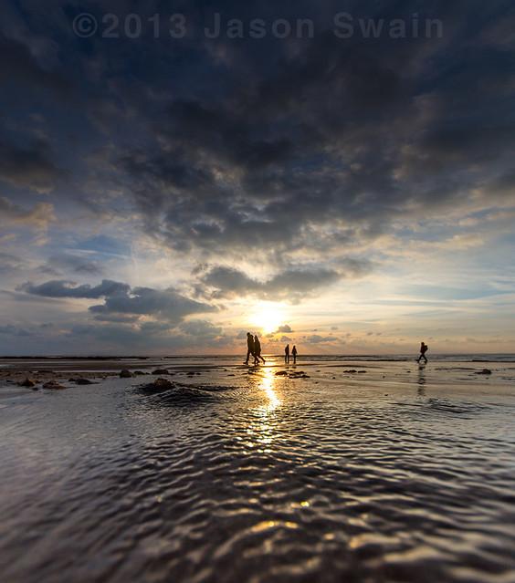 Low tide walks along the beach