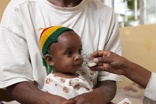 Mustapha and his one year old daughter Meia-Teza Wota Health Center Clinic | by UNICEF Ethiopia
