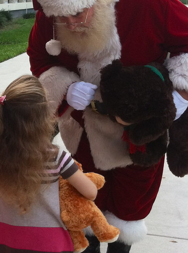 Bella talking business with Santa | by adoptabearorg