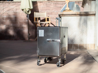 Small smoker on wheels and outside bbq patio area perfect for summer meat smoking | by yourbestdigs