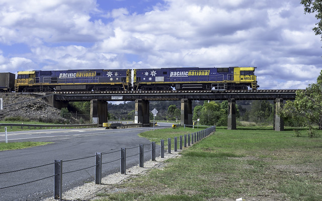 Pacific National locomotives NR52 and NR45 on historic 1863 Railway Bridge over Nepean River at Menangle NSW