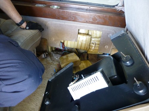 <p>Customs and Border Protection agents find packages of heroin cleverly hidden in the side panels of this car.</p>