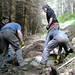 Sat, 08/04/2007 - 11:36 - On the 4th of August 2007 the Glentress Trailfairies decamped to Elibank forest in order to help prepare part of the course for the Selkirk Merida Marathon being held the following day.  Matthew and Andy manoeuvre a large stone into place, adding some interest and a stone step into an otherwise largely featureless descent.