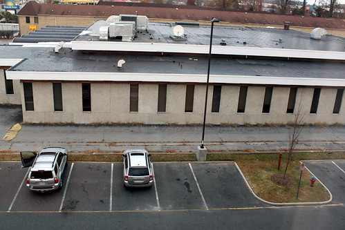 city urban cars window hotel parkinglot gray ugly bleak scape rectangle 109 112picturesin2012
