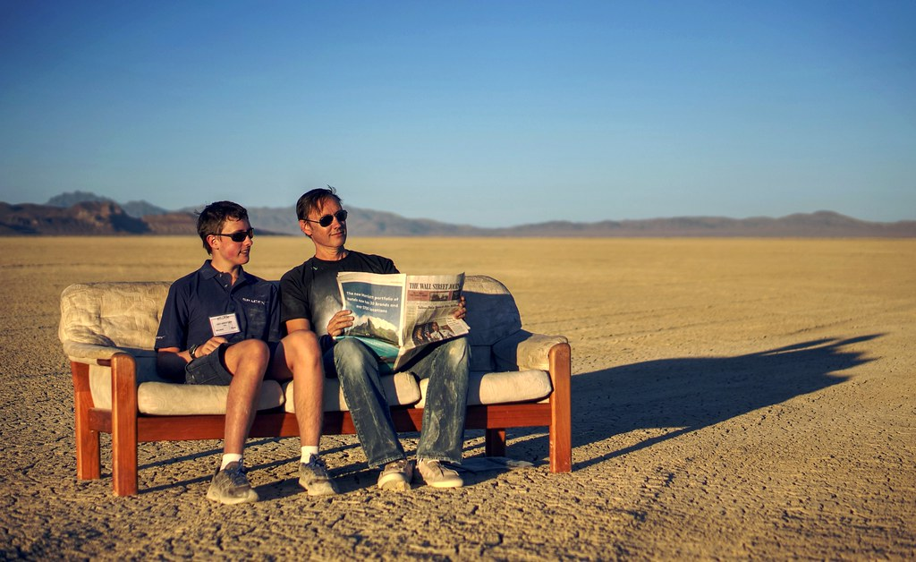 Just a father and a son chilling on a couch in the desert