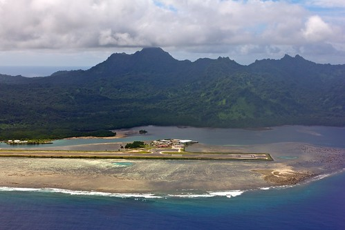 ocean blue sea mountains water island inflight airport day cloudy terminal apron reef runway micronesia ksa kosrae islandhopper federatedstates