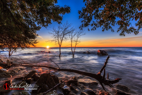 boulderpoint clouds discoverwisconsin greatlakes horizon lakemichigan landscape milwaukee rocks sunrise travel trees water waves canon 5dmarkiii dearmke mkemycity mke bradfordbeach landscapephotography andrewslaterphotography