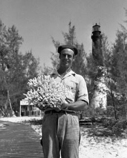 Coast Guardsman holding coral near the Loggerhead Key Lighthouse in the Dry Tortugas