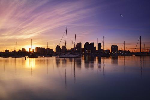 city sky sun reflection water sunshine night clouds marina sunrise dawn bay harbor downtown day cityscape waterfront sandiego sailboats