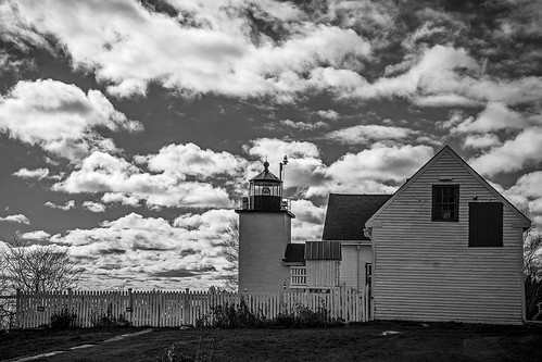ocean sky bw lighthouse water grass clouds blackwhite maine newengland coastline fortpointlighthouse stocktonsprings fortpointstatepark robertallanclifford cliffordphotographynhcom