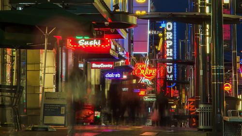 vancouver granville street streetview neon lights sidewalk lowpov dusk storefront signage nightphotography streetphotography nikon d7000 dslr downtown cityscape cityscene citylights vancitybuzz retail night nightlife