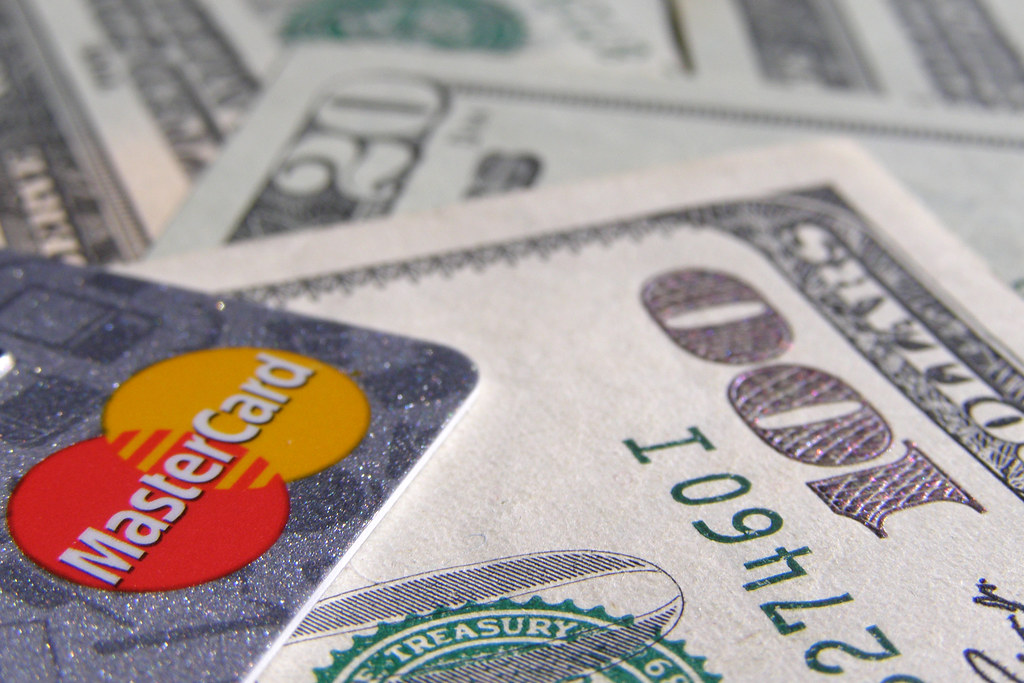 A mastercard and a hundred dollar bill