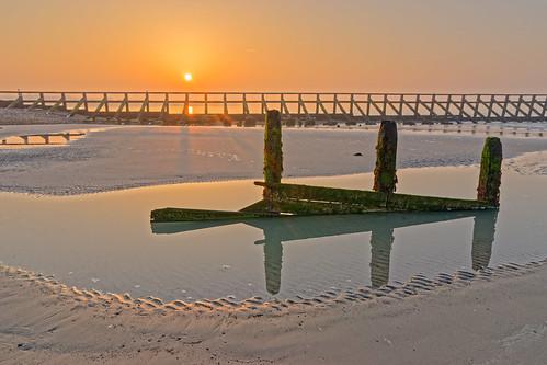 sunrise dawn daybreak sunset sun beach sand water sea reflection tide wall pool glow
