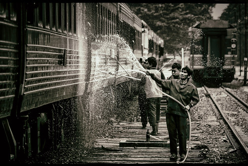 chiangmaistation chiangmairailwaystation cleaning washing water hoses spraying maintenance crew workers splash splashing carriages coaches chiangmaithailand northernthailand southeastasia asian thai siam srt staterailwayofthailand transportation railroadtracks sepia monochrome story pressurespray wash droplets mist candid action streetphotography streetshooting rinsing backlight hydro highpressure facialexpressions nikond5100 tamron18270 photoshopbyfehlfarben thanksbinexo