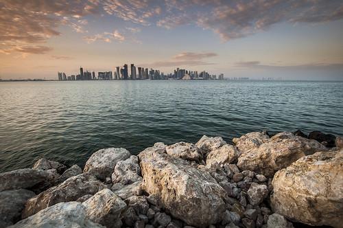 trip sunset sea skyline clouds landscape rocks cityscape gulf skyscrapers dusk sigma wideangle shore arabian doha qatar arabiangulf sigma1020mm ultrawideangle qatarliving december2012