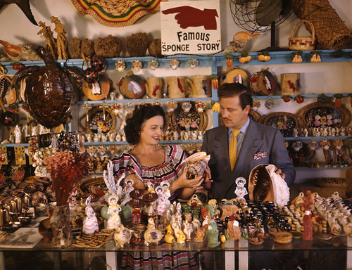 John M. Gonatos in his curio shop with assistant Niki Vasilikis: Tarpon Springs, Florida | by State Library and Archives of Florida