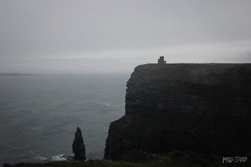 ocean christmas travel ireland winter irish tower castle galway water grass fog clouds composition dark landscape europe clare waves moody tour view darkness hiking walk framed scenic cliffs atlantic adventure walkway neo cliffsofmoher soulful aranislands 2012 galwaybay obrienstower spyre