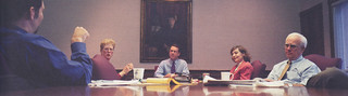 Dean of Admissions Bruce Poch; Treasurer Carlene Miller; President Peter Stanley; Dean of Admissions Ann Quinley; and Dean of the College Hans Palmer in a Monday meeting of the executive staff in 1999.