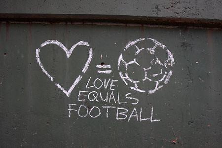 sprawdzić wyprzedaż w sklepie wyprzedażowym kupować nowe Puma 2 | Graffiti reading 'Love Equals Football' is seen on ...