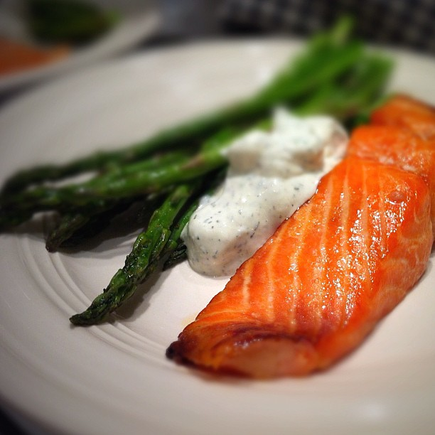 Broiled salmon and asparagus with cucumber dill sauce.
