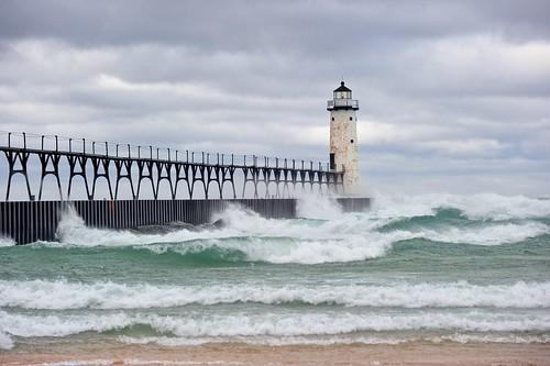 sky usa lighthouse storm beach nature clouds landscape pier midwest waves michigan scenic landmark lakemichigan greatlakes coastline draco johnmccormick manisteelighthouse michigannutphotography stormdraco