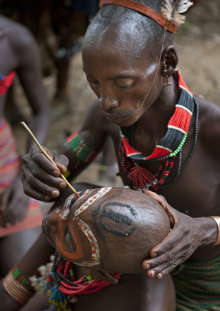 Hamer Man Having His Face Painted For Celebration Of Cow Jumping Ceremony Omo Valley Ethiopia