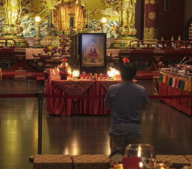 A man prays at the Buddha Tooth Relic Temple in Singapore