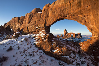 First Light on Turret Arch Framed by North Window - Wide | by ArchesNPS
