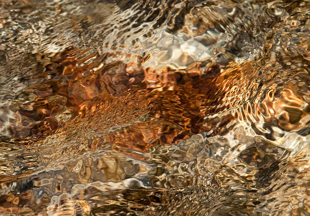 Close-up of water over rocks