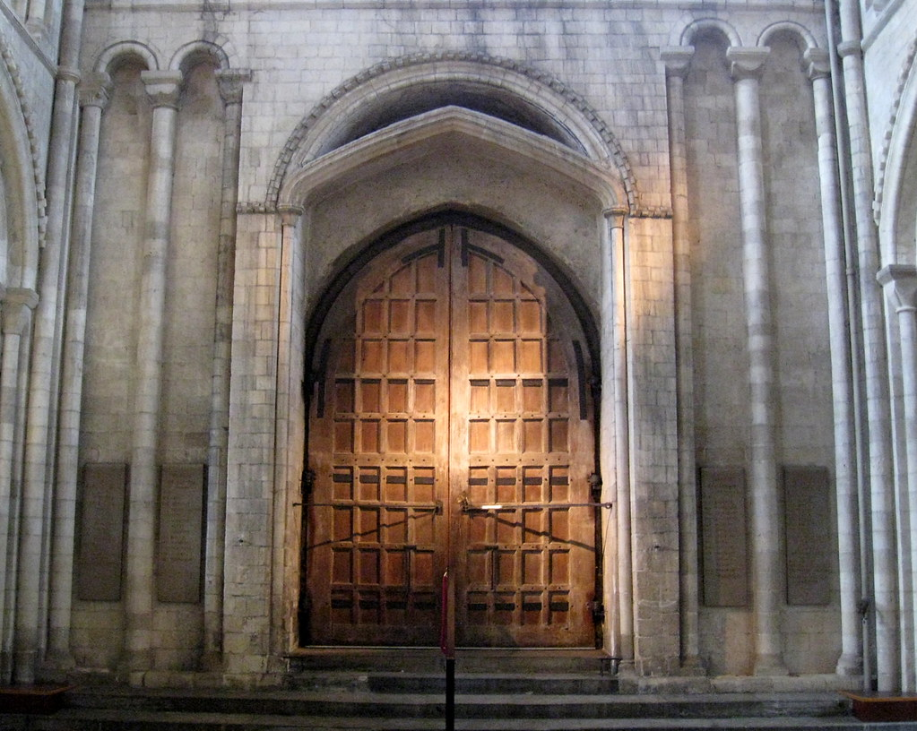 West Norman doorway with Perpendicular pointed-arch insert
