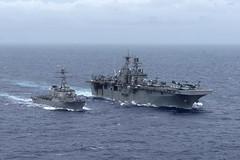 USS Curtis Wilbur (DDG 54) steams alongside USS Bonhomme Richard (LHD 6) in the Philippine Sea. (U.S. Navy/MC2 Kyle Carlstrom)